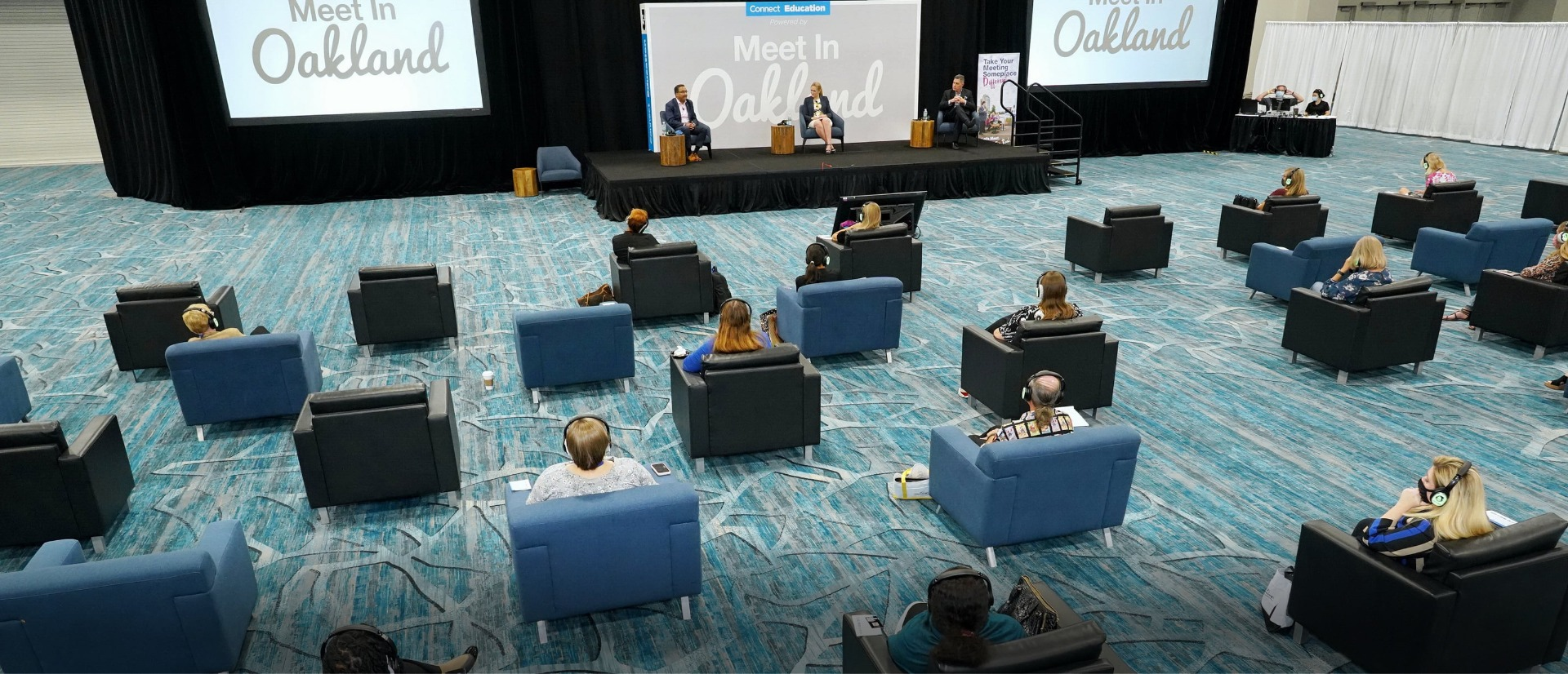 Blue and black chairs in socially distanced general session